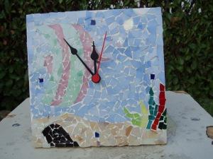 orologio con mosaico pesci