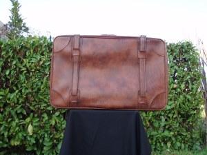 valigia marrone in pelle
